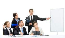 Business man showing something on screen to the group of people. Manager showing something on screen to the group of managers, isolated on white. Concept of royalty free stock photos
