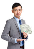 Business man showing spread of Cash Royalty Free Stock Images