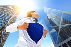 Business man showing superhero suit Stock Images
