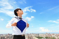 Business man showing superhero suit Royalty Free Stock Photo