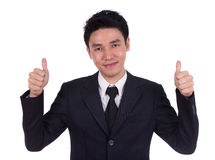 Business man showing thumbs up gesture Stock Images