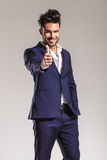 Business man showing the thumbs up gesture. Royalty Free Stock Images