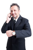 Business man showing time for meeting gesture Stock Image