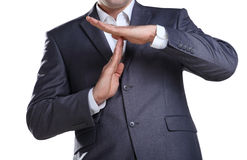 Business man showing time out sign Stock Images