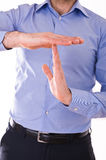 Businessman showing time out sign with hands. Stock Images
