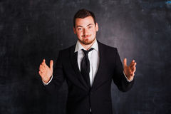 Business man showing to the size Royalty Free Stock Photography