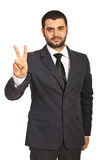 Business man showing victory Stock Photography