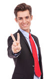 Business man showing victory sign. Bright picture of handsome business man showing victory sign Royalty Free Stock Photography