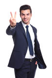 Business man showing the victory sign Stock Photography