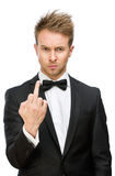 Business man showing vulgar gesture. Half-length portrait of manager showing obscene gesture, isolated on white. Concept of stress and aggression Stock Image