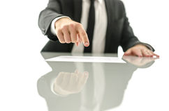 Business man showing where to sign a document. Front view of business man showing where to sign a document. over white background stock photos