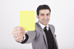 Businessman showing yellow card Stock Images