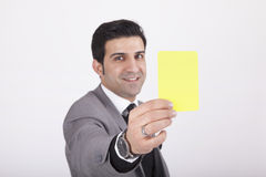 Businessman showing yellow card Stock Photo