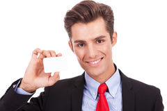 Business man showing you his business card Stock Photo