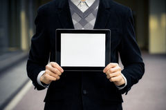 Business Man Shows Blank Digital Tablet. Businessman holding digital tablet pc with blank screen Royalty Free Stock Photo