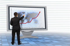 Business man shows financial growth. Business man showing financial growth on a 3d rendered Lcd monitor Royalty Free Stock Photos