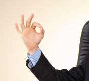 Business man shows gesture by fin Royalty Free Stock Image