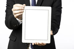 Business man shows his blank tablet computer Stock Photo