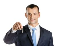 Business man shows key Stock Images