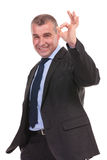 Business man shows the ok sign Stock Images