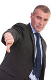 Business man shows thumb down Stock Photo