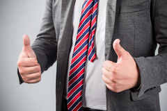 Business man shows thumb up Royalty Free Stock Images