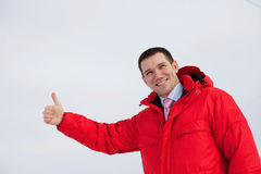 Business man shows thumb up outdoor Royalty Free Stock Images
