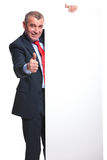 Business man shows thumb up at panel Stock Image