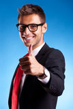 Business man shows thumbs up ok gesture Stock Photography