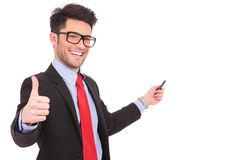 Business man shows thumbs up & points Stock Image