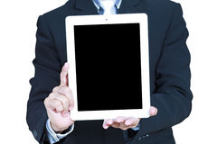 Business man shows touch screen tablet Royalty Free Stock Images