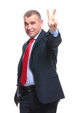 Business man shows victory sign Stock Photo