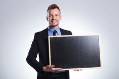 Business man shows you a blackboard Royalty Free Stock Photos