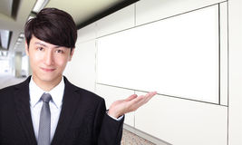 Business man shows you empty billboard Royalty Free Stock Photography