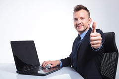 Business man shows you the thumb up Royalty Free Stock Image