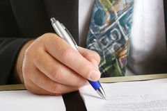 Business man siging a contract Royalty Free Stock Photo