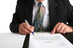 Business man siging a contract Royalty Free Stock Images