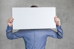 Business man. Sign in front of head of business man Stock Photography