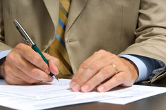 Business Man Signing Royalty Free Stock Photos