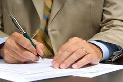 Business Man Signing royalty free stock photos