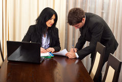 Business man signing a contract. Business  man signing a contract for a manager woman  in a meeting room Stock Photo