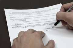 Signing the contract. Business man signing a contract Royalty Free Stock Photos