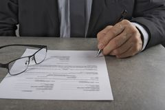 Business man signing  a contract making a deal, classic business concept. Royalty Free Stock Images