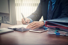 Business man signing contract making a deal Royalty Free Stock Image