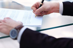 Business man signing a contract. In modern light office Royalty Free Stock Photo