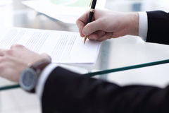 Business man signing a contract. In modern light office Stock Photo