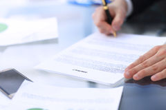 Business man signing a contract. In modern light office Stock Photos