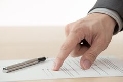 Business man signing finance contract. On table Royalty Free Stock Photo