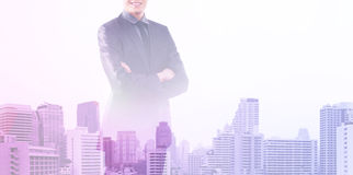 Business man on a silhouette of a city Royalty Free Stock Photo