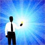 Business man silhouette with light bulb Royalty Free Stock Images